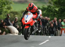 Thumbnail of Ryan Farquhar leaping Ballaugh Bridge during practice for the 2008 TT