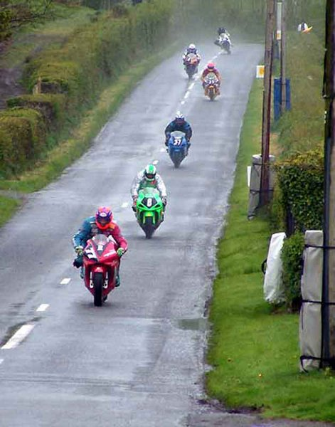 A wet Tandragee 100 - 2003 Ryan leading the pack