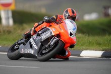Thumbnail of Ryan Farquhar on the Harker Racing machine during Thursday evening's practice session at the 2008 TT