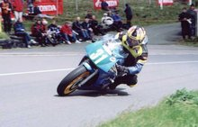 Thumbnail of Rounding the Bungalow TT2002