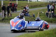 Thumbnail of Sidecar team Dave Molyneux and Dan Sayle during Thursday evening practice at the 2008 TT