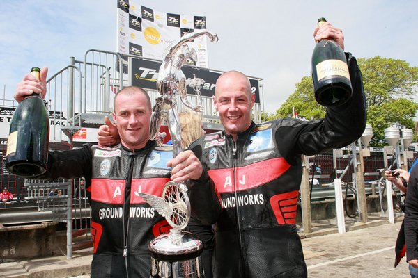 Nick Crowe and Mark Cox celebrate winning the second Sure Mobile Sidecar TT race in 2008