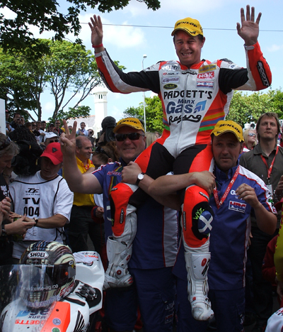 John McGuinness celebrates victory in the 2008 Senior TT