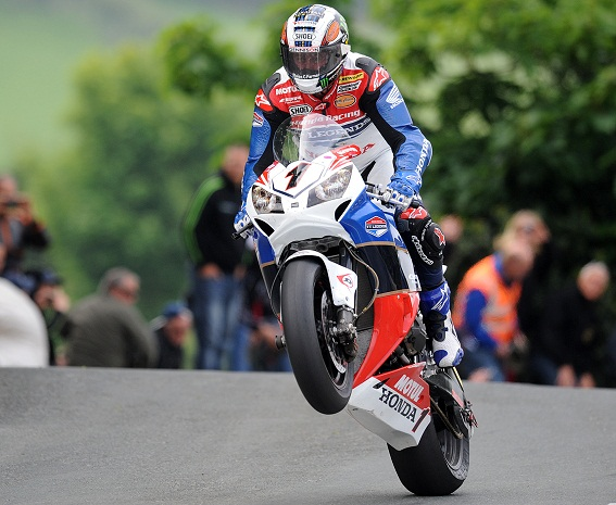 John McGuinness on his way to victory in the Dainese Superbike TT at the 2012 Isle of Man TT