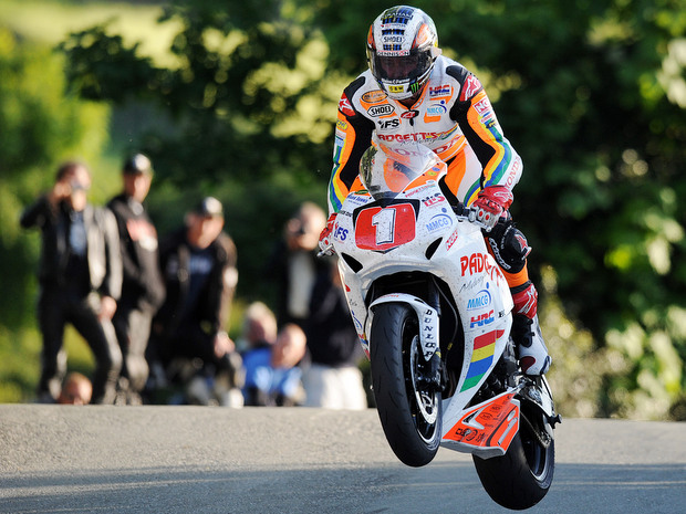 John McGuinness on his way to his 19th win at the Isle of Man TT, and his first victory in the Superstock class