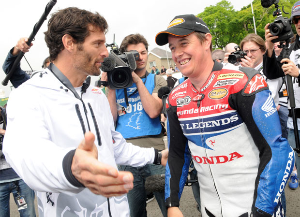 Mark Webber and John McGuinness in a media scrum