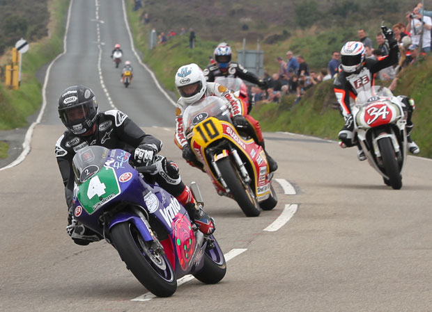 Picture by Dave Kneen at manxphotosonline shows John McGuinness (4), Mick Grant (10), Steve Plater (34) and Philip McCallen at the Creg Ny Baa during the 2013 Classic Racer Lap of Honour.