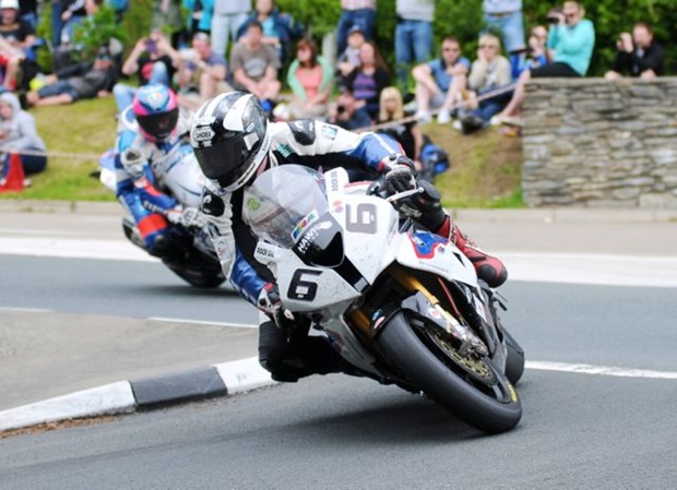 Michael Dunlop won the 2014 PokerStars Senior TT riding a Hawk Racing BMW S 1000 RR super bike. Here he leads Guy Martin into Governor's Bridge dip