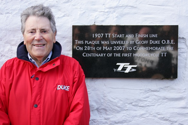 Geoff Duke unveils a plaque to commemorate the centenary of the Isle of Man TT
