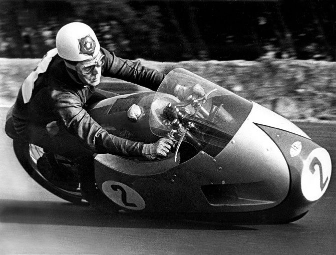 Geoff Duke on the 500 Gilera 4-cylinder with full fairing