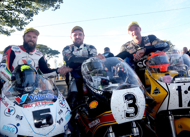 Bruce Anstey, Michael Dunlop and Ryan Farquhar in the winners' enclosure following the 2015 Motorsport Merchandise Formula One Classic TT Race