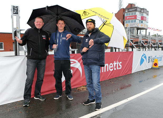Clerk of the Course Gary Thompson with Classic TT riders Dean Harrison and Bruce Anstey assessing the weather conditions on Saturday 20th August - the forecast for Monday 22nd August is much improved. Photo credit: Dave Kneen / Manxphotosonline.com