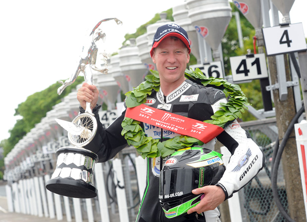Lincolnshire's Gary Johnson celebrates his second TT win following the 2014 Supersport TT race