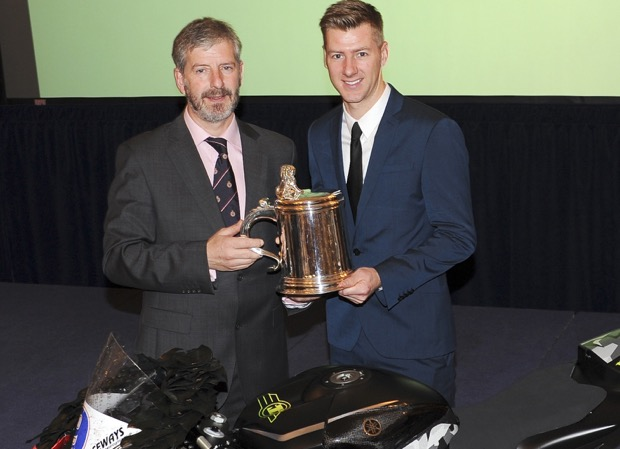 Ian Hutchinson being presented with the Torrens Trophy