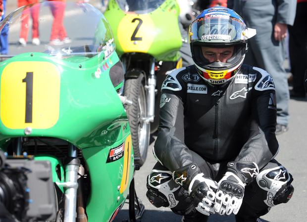 John McGuinness waits by the side of the Winfield Paton for the start of the 500cc Classic TT race