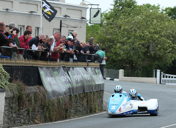 John Holden and Andy Winkle sweep past the crowd at the Raven Hotel in Ballaugh