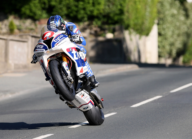 Ian Hutchinson took his Tyco BMW Superstock bike round the Isle of Man TT Mountain Course in a new unofficial absolute record speed of 132.803mph