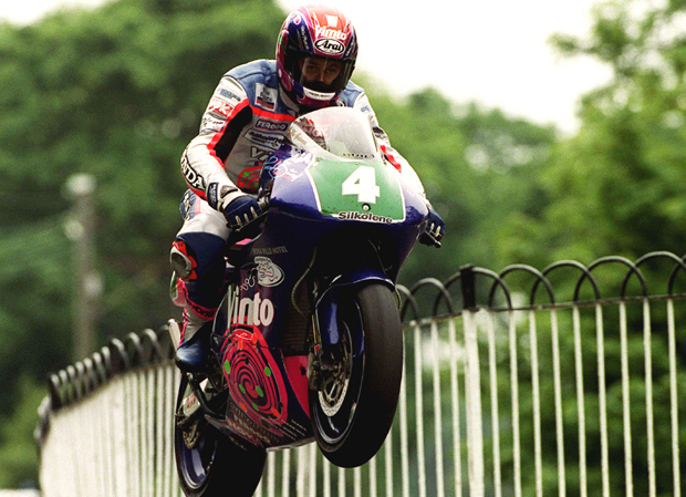John McGuinness leaps Ballaugh Bridge on his way to winning the 1999 Lightweight TT