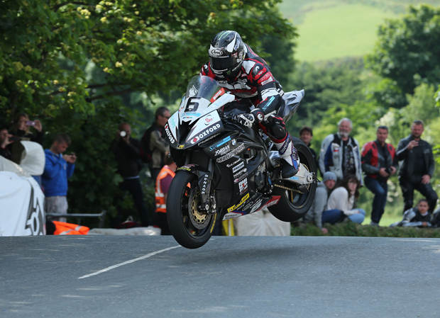 Michael Dunlop jumps Ballaugh Bridge on his way to winning the opening RST SUperbike TT Race in race- and lap record time