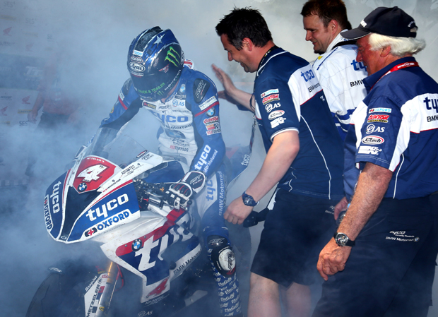 Hutchy does a burn out to celebrate his win in the RL360º Superstock TT - Tim Keeton / Impact Images Photography