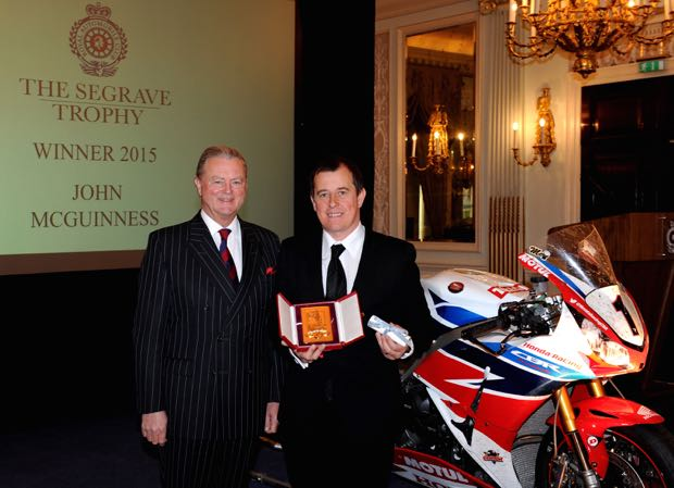 John McGuinness is presented with the coveted Segrave Trophy by Tom Purves, Chairman of the Royal Automobile Club