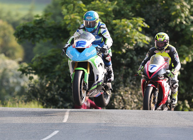 Dean Harrison leads Gary Johnson over Ballaugh Bridge in the first qualifying session of TT 2016
