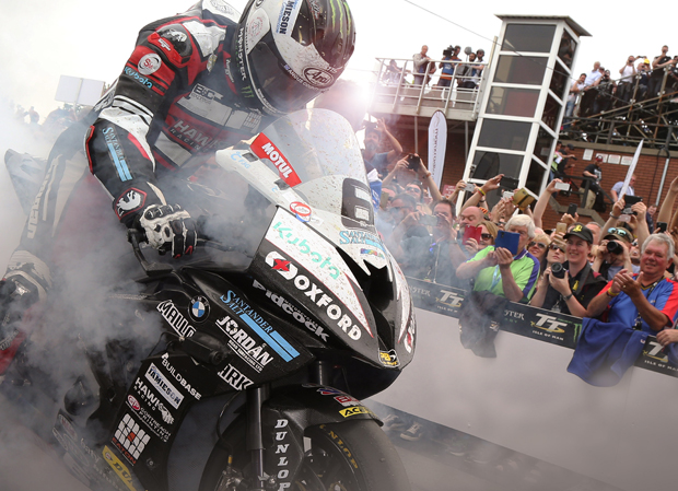Michael Dunlop performs a burnout for the crowds as he wins the 2016 PokerStars Senior TT