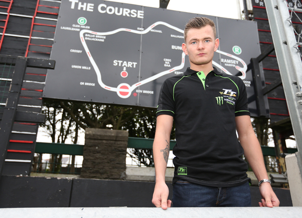 18-year-old Joe Thompson in front of the famous map of the Isle of Man TT Mountain Course