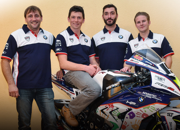 Team Principal Rico Penzkofer (left) with riders Dan Kneen (on bike), Alex Polita and Danny Webb