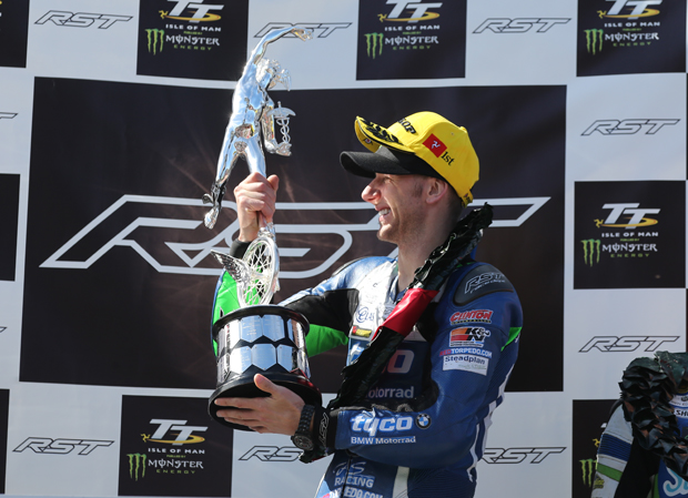 Ian Hutchinson lifts the winner's trophy for the RST Superbike TT Race - his fifteenth TT win