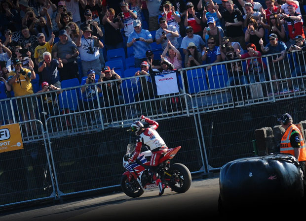 John McGuinness salutes the crowd on the Noble's South grandstand