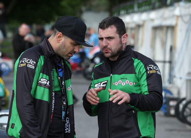 Michael Dunlop talks with his Paton teammate ahead of the start of the qualifying session