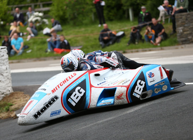 Ben and Tom Birchall rounds Governor's Dip on their way to setting a new sidecar lap and race record.