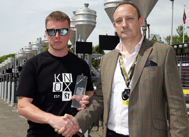 Ryan Kneen receives the PokerStars Spirit of the TT Award from Guy Templer, of the Stars Group