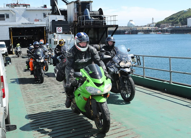 riders leave the Isle of Man Steam Packet Company's ferry in Douglas